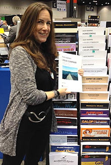 Alex Shapiro, at her Hal Leonard rack display at the Midwest Clinic in 2015.